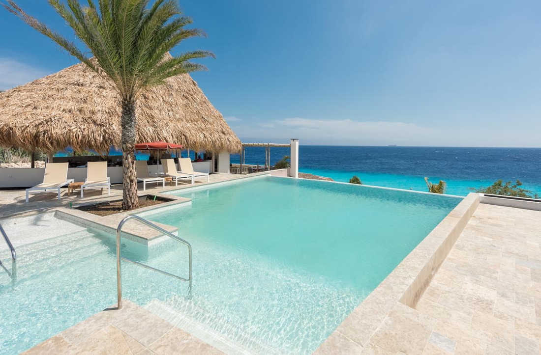 Oasis Coral Estate Beach, Dive & Wellness Resort, Pool and Beach View